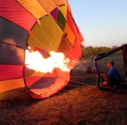 The pilot applies heat to the inside of the balloon.