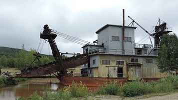 A gold dredge, long ago stopped working.