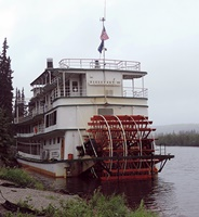 Stern-wheel tour boat.