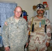 SFC Wood posing with the Iraqi platoon sergeant.