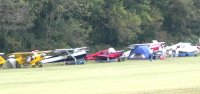 Tents and airplanes make for a colorful campground.