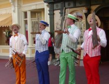 A barbershop quartet that is typical of the roving street entertainers found in all four parks.