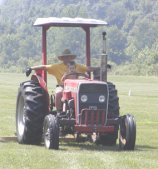 Our main taks was mowing the field. In this case our grandson was assisting.