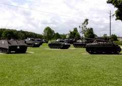 Field display of armored vehicles from world war two to Vietnam.