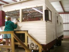 This early, home built, motorhome is displayed. All items in it work.