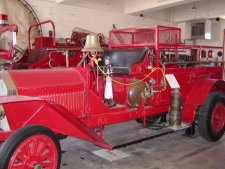 An old firetruck built by Mack.