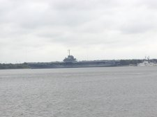 The aircraft carrier, CVA 10 can be seen on display in the harbor.