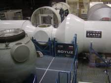 Mock-ups of the new space station occupy the major share of the lab. These sections are of the portion of the station built by Russia.
