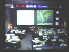 This picture was taken of a TV monitor that shows the current mission control center as it is in use for the countdown for