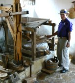 Kirk works as miller for the restored grist mill.