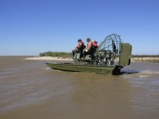 A biologist and volunteers head out to the rookery island on the airboat.