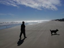 Pam and Muffie walk the beach at Quintana Co. Park.