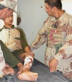 Two Iraqi medics treat a burn patient.