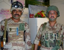 The Iraqi platoon sergeant poses with one of the Iraqi medics.